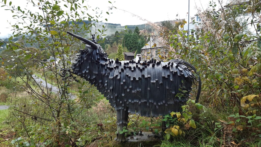 Hairy Coo statue in Strathyre